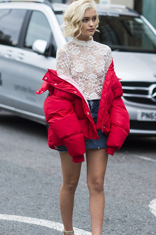 This outfit may be risky, but it's a good risk. The model is wearing a sheer white lace with a denim skirt. The white lace stands out in contrast with the girl's skin colour. She opted for a red oversized bomber jacker to give the outfit a pop of colour.