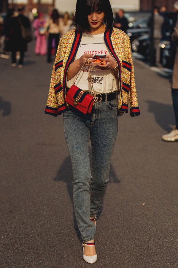Street Style Picture From Milan Fashion Week Autumn /Winter 2018. Lady wearing channel style tweed jacket in yellow with gucci style binding finish. Dressed with gucci top, belt and jeans.