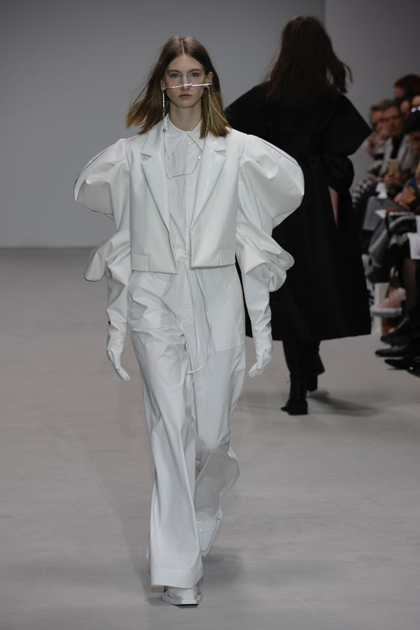 LCF graduate Jiali Lu presents a Jane Austen inspired tailored all-white look for LFW AW/18