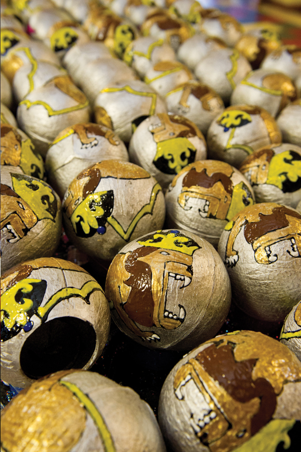 Coconuts from the Mari Gras carnival. The fruit is decorated with traditional imagery.