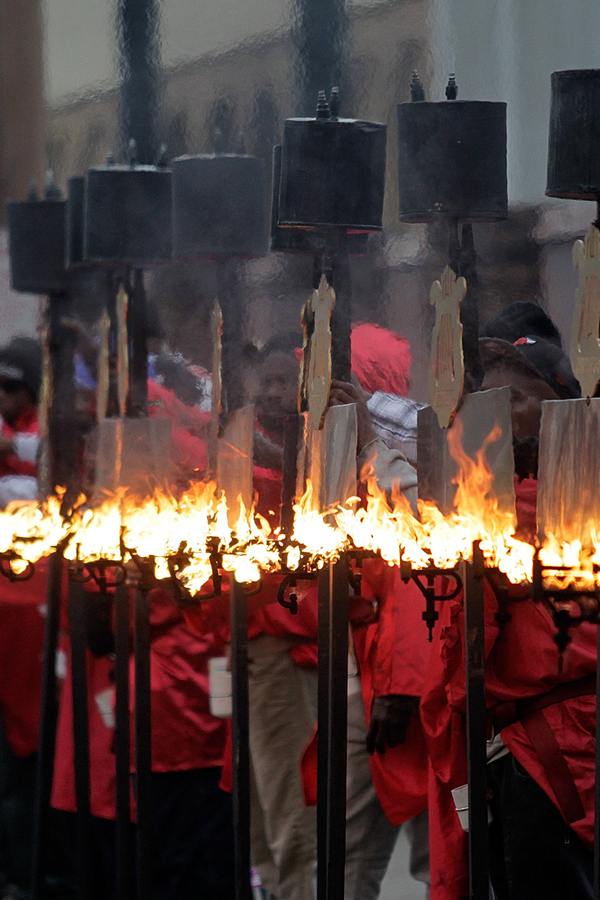 Traditional Flambeaux procession of flaming torches at Mardi Gras.