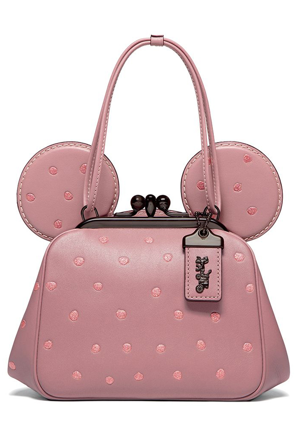 Disney x Coach - Pink Mini Mouse Leather Handbag from Collaboration - Handbag has ears and glittery spots. The clasp fastening and tag are a black brush metal. Refinery 29