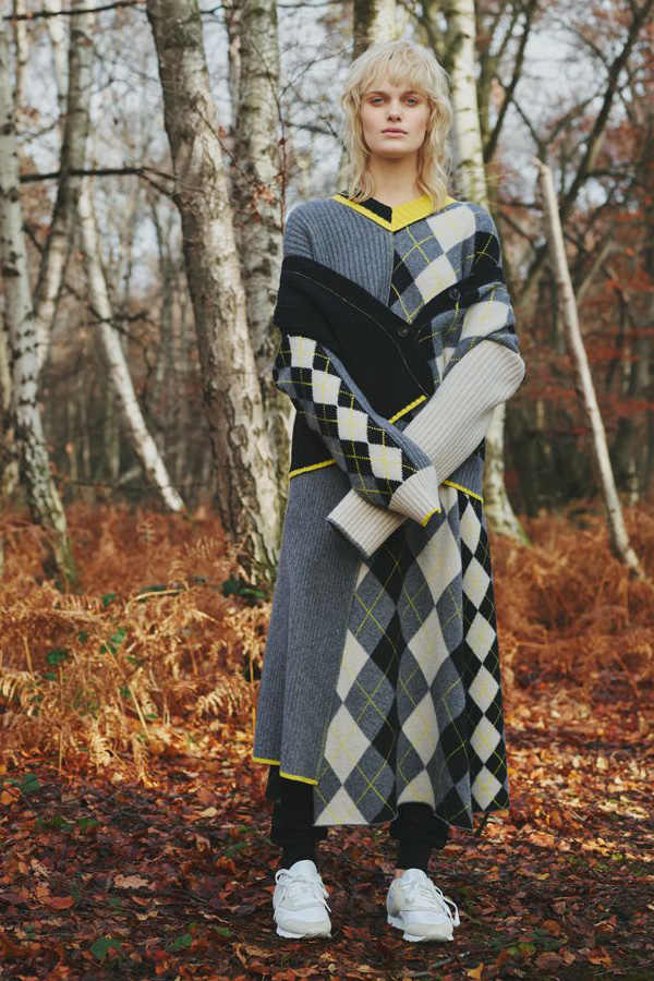 A Preen look from their Pre Fall 2018 collection with argyle pattern in a patchwork panel style. Layering is key here with a matching jumper and a skirt and dress combination.