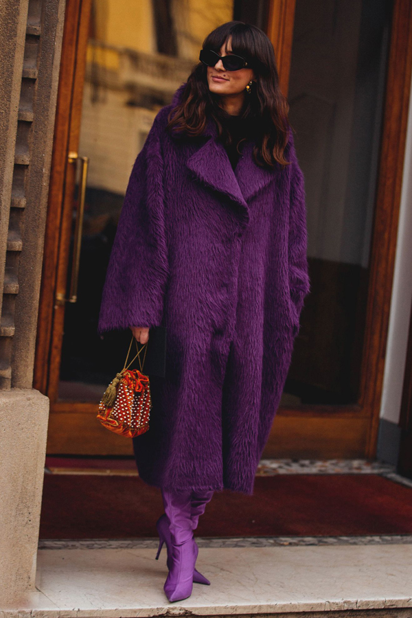 Street Style Picture From Milan Fashion Week Autumn /Winter 2018. Lady wearing all purple. Purple fur coat and boots.