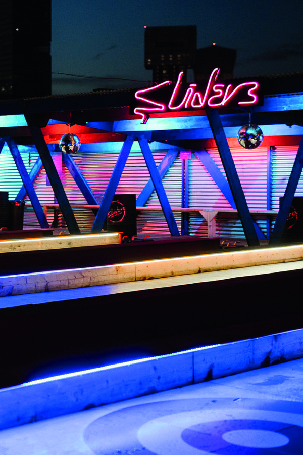 Image of sliders at roof east bar london. This is a place to do curling activities.
