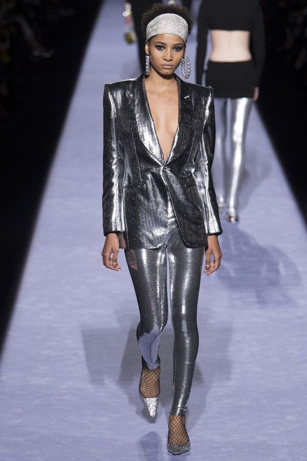 Tom Ford catwalk featuring a metallic look of leggings and tailored blazer for a night outfit. Big hoop earrings with extra sparkle add to the 80s feel.