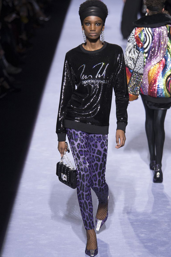 Tom Ford autumn/ winter 2018 catwalk. This look features a sparkly beverly hills jumper and leopard print metallic leggings.