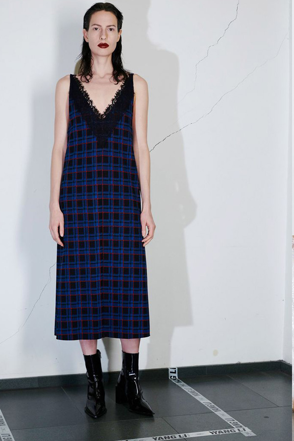 A Yang Li look for Pre Fall 2018, showcasing how tartan can be romanticised and feminised with lace.